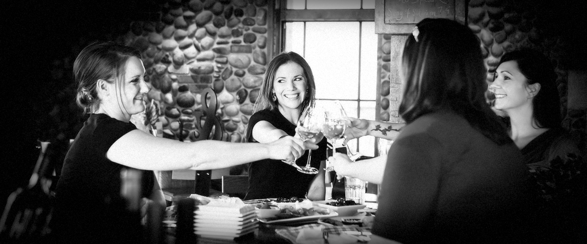 Ladies Toasting in 2Hawk Vineyard and Winery Tasting Room (Grayscale)