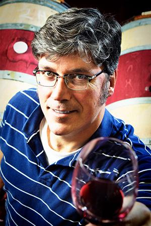 2Hawk Vineyard and Winery Winemaker Kiley Evans Raising Glass