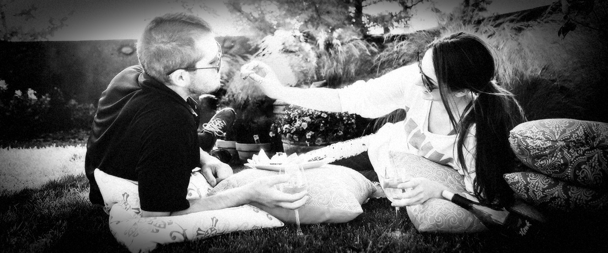 Couple Wine-Tasting and Picnicking at 2Hawk Vineyard and Winery (Grayscale)