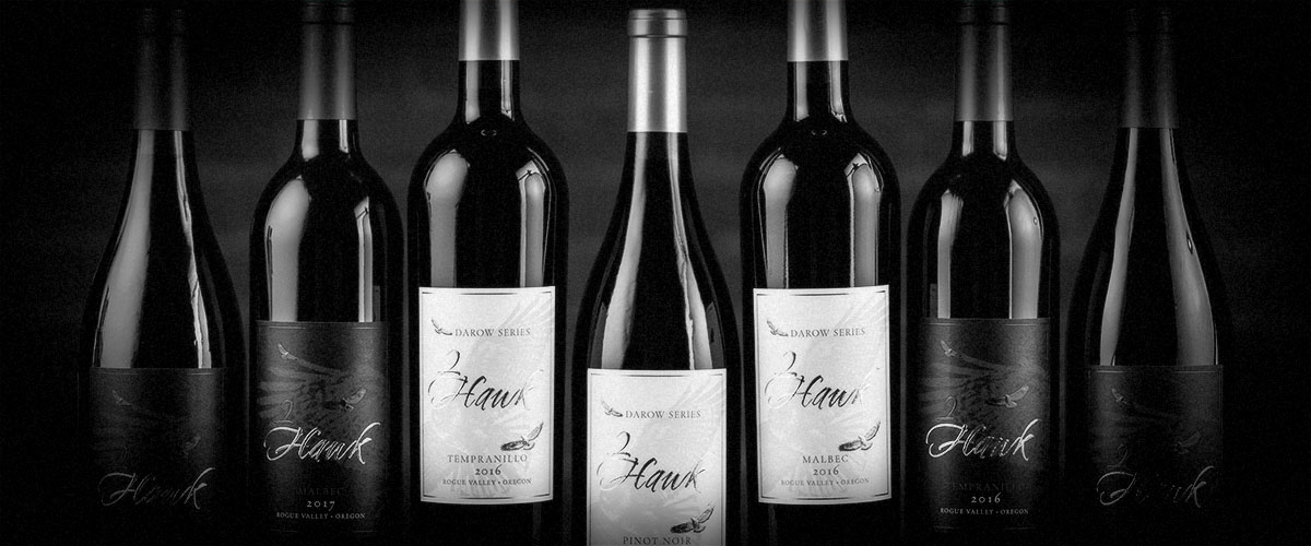 2Hawk Vineyard and Winery Darow Series Wines and Other Wine Bottles (Grayscale)