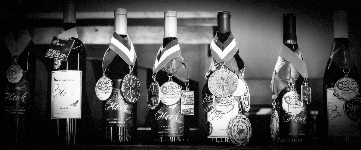 2Hawk Bottle Lineup with Awards (Grayscale)