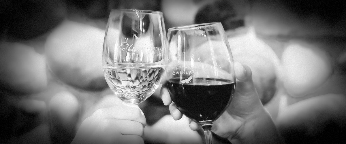 Toasting Red and White 2Hawk Wines (Grayscale)